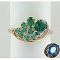 Золотое кольцо с синтетическими изумрудами